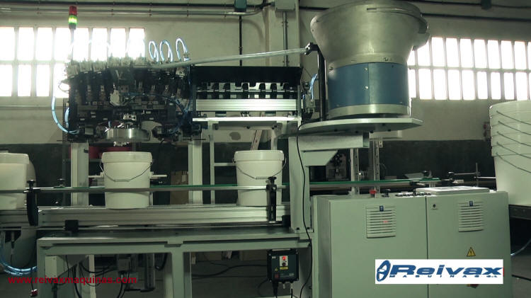 Machine to manufacture: Wire handles with plastic container insert. Model AS-R1.